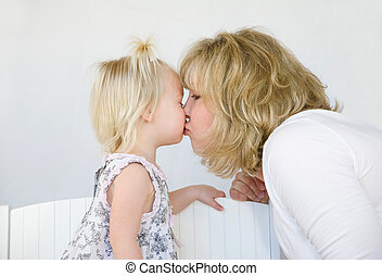 Mother Kissing Daughter - Mother Giving Little Girl a Big...