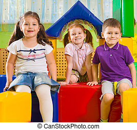 Cute children playing in gym - Cute children playing in...