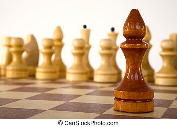 Chess bishop - Brown chess bishop on a white background
