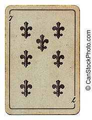 old used grunge playing card with number seven isolated on...