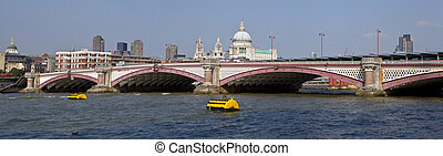Blackfriars Bridge in London The dome and towers of St Pauls...