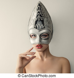Beautiful young woman in venetian carnival mask - Beautiful...