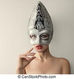 Beautiful young woman in venetian carnival mask - Beautiful...