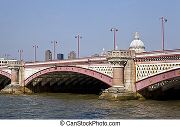 Blackfriars Bridge in London. The dome and towers of St....