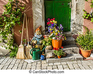 Happy gardening - House with watering can, garden gnome,...