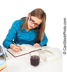 Concentrating - Young businesswoman concentrating on her...
