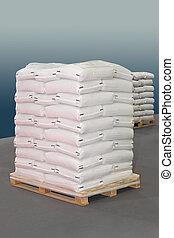 Sacks pallet - White polypropylene sacks at transport pallet
