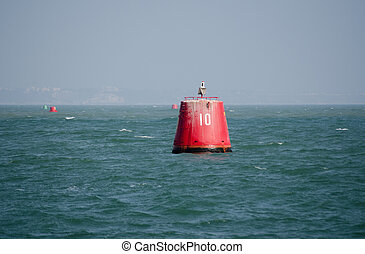 Number ten buoy - A large, red marker buoy, labelled 10 at...