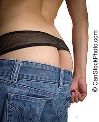 Woman showing ass in G-string  and jeans.