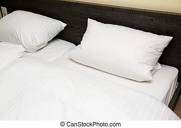 two pillows on the bed
