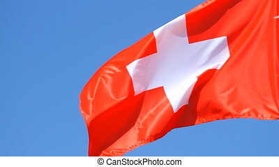 Flag of Switzerland on the blue sky
