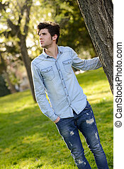 Attractive young handsome man, model of fashion