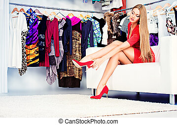 high heels shoes - Fashionable girl choosing shoes in a...