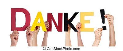 People Holding Danke - People Holding the German Word Danke...