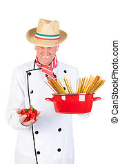 Italian cook with pan pasta and tomatoes
