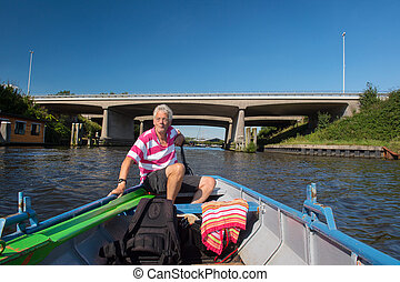 man in boat at the river - Elderly man in boat at the river