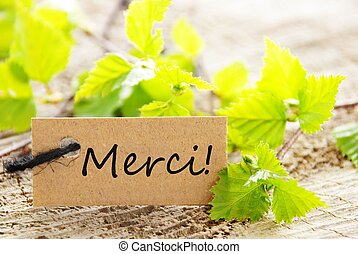 Label With Merci - A Label With the French Word Merci Which...
