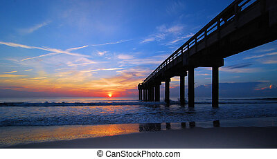 Red Horizion - The St Augustine Beach Pier at sunrise:...