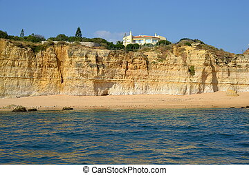 Caves cliffs yellow Albufeira in the Algarve