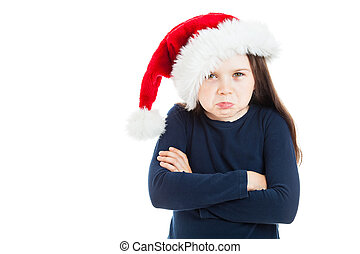 Portrait of a little pouting Christmas girl, looking...
