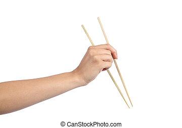 Woman hand using a chopsticks