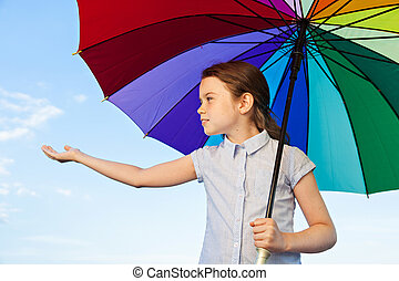 Little cute girl with umbrella - Little girl is standing...