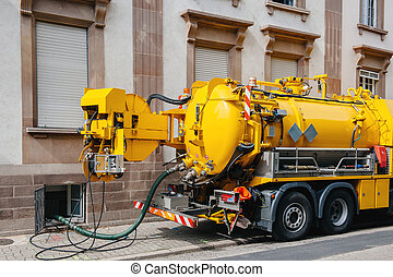 Sewerage truck on street working - clean up sewerage...