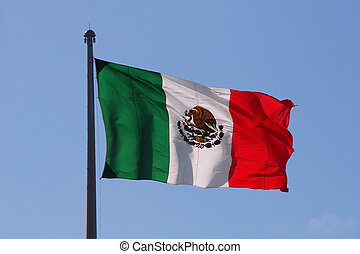 Mexican flag over blue sky