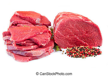 huge red meat chunk and steak isolated over white background...