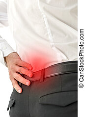 Painful lower back - Closeup of male with lower back pain.