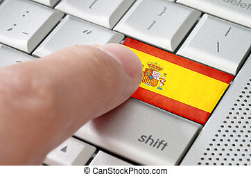 Business concept male finger pressing Spain enter key on...