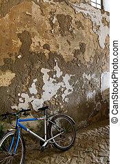 Old bike against wall