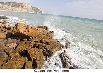 Waves crashing on rocks - The Crashing of waves on shore...