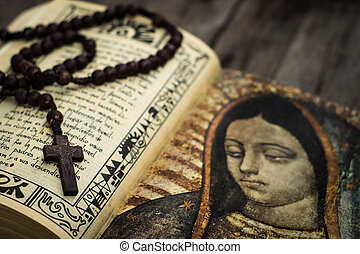 Religious Concept - A Religious concept of a rosary and a...
