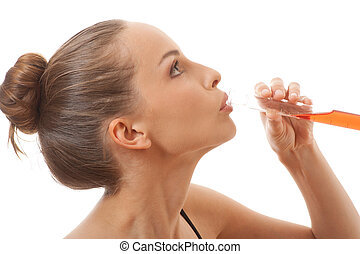 woman drinks red liquid from a test tube