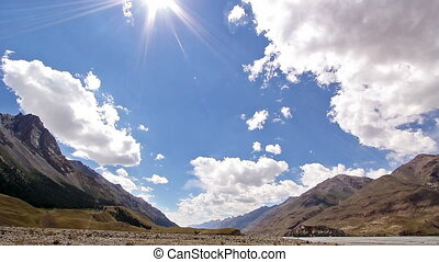 Clouds and sun in the mountains. Kirgystan, central Tien...