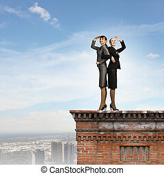Business perspective - Image of two businesswomen looking...