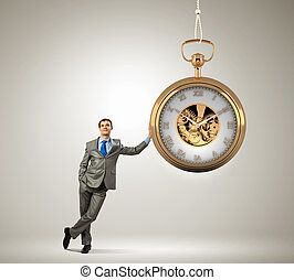 Time is money - Image of young businessman and pocket watch....