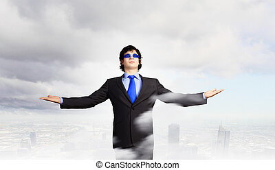 Success in business - Image of powerful businessman standing...