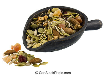 pile and scoop of healthy trail mix - trail mix with...
