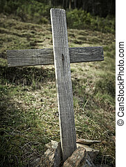 Old wooden crossed on a hill