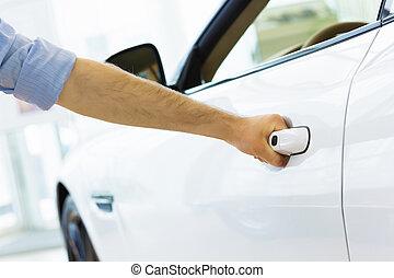 Man opening car - Close up human hand opening car door
