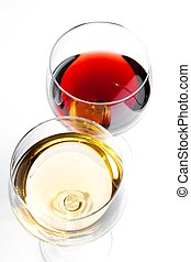 top of view of red and white wine glasses on white...