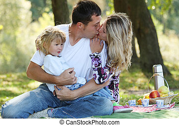 Young family having a picnic in nature