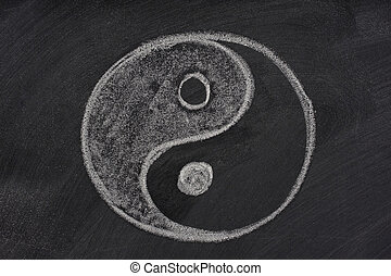 yin and yang symbol on a blackboard - yin and yang symbol...