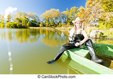fishing woman sitting on boat