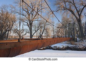 old rusty aqueduct across a river