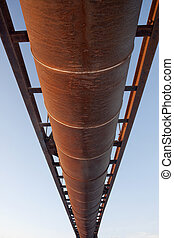 suspended rusty pipe shot from below
