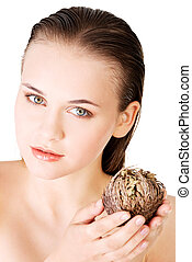 Beautiful spa woman holding Rose of Jericho