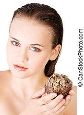 Beautiful spa woman holding Rose of Jericho